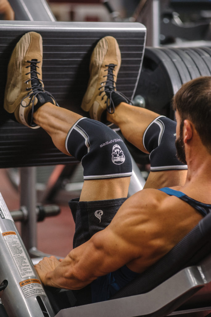 man doing leg presses